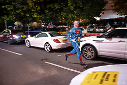 "© Licensed to London News Pictures . 28/10/2018. Manchester, UK. A man dressed as Superman runs along the road in Manchester's "" Gay Village "" . Revellers on a night out , many in fancy dress , on the weekend before Halloween . Photo credit: Joel Goodman/LNP"