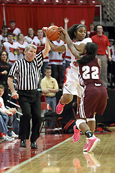 03 March 2013:  Stekara Hall is watched by referee Scott Starkey and fouled by Tyonna Snow during an NCAA Missouri Valley Conference (MVC) women's basketball game between the Missouri State Bears and the Illinois Sate Redbirds at Redbird Arena in Normal IL