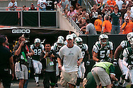 Brett Favre runs on to the field after his press conference  August 7, 2008 at Cleveland Browns Stadium.