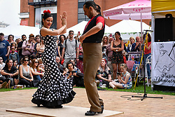 """© Licensed to London News Pictures. 27/05/2018. LONDON, UK.  Flamenco dancers entertain the crowds at """"Feria De Londres"""", on the Southbank.  The three day festival held over the bank holiday weekend celebrates the culture of the Andalusian region of Southern Spain through dance, food and music.  Photo credit: Stephen Chung/LNP"""