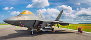 Panoramic image of an F-22 Raptor (and crow), created from two separate exposures and then merged together.  Lakeland, Florida.  <br />