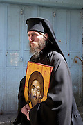The Via Dolorosa Procession, Jerusalem, Israel, Good Friday Easter 2005 a priest carrying a picture of Christ