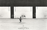 kids playing baseball in empty lot