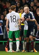 Steven Naismith of Scotland challenges Stephen Quinn of Ireland  - UEFA Euro 2016 Qualifier - Scotland vs Republic of Ireland - Celtic Park Stadium - Glasgow - Scotland - 14th November 2014  - Picture Simon Bellis/Sportimage