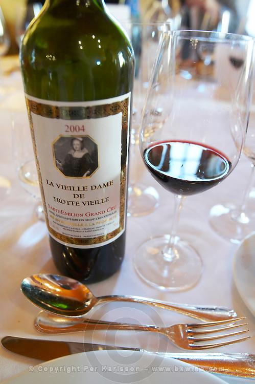 bottle and glass with wine at dinner table la vieille dame de chateau trottevieille saint emilion bordeaux france