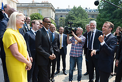"""Virginia Rometty, Mark Zuckerberg, Paul Kagame and Emmanuel Macron doing a family picture during the """"Tech for Good"""" summit over lunch with tech companies CEOs at the Elysee Palace, Paris, France, on May 23, 2018. Photo by Jacques Witt/pool/ABACAPRESS.COM"""