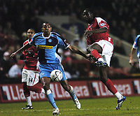 Photo: Olly Greenwood.<br />Charlton Athletic v Wycombe Wanderers. Carling Cup. 19/12/2006. Wycombe's Kevin Betsy goes past Charlton's Amady Faye