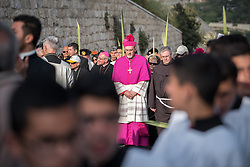 14 April 2019, Jerusalem: On Palm Sunday, thousands gathered and marched from the Mount of Olives down to the Old City of Jerusalem, following in the footsteps of Jesus, as he journeyed to Jerusalem. Here, the head of the Roman Catholic Church in the Holy Land, titular Archbishop of Verbe and Apostolic Administrator of Jerusalem Pierbattista Pizzaballa.