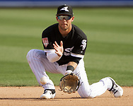 GLENDALE, ARIZONA - MARCH 04:  Nick Madrigal #92 of the Chicago White Sox fields against the Los Angeles Angels on March 4, 2019 at Camelback Ranch in Glendale Arizona.  (Photo by Ron Vesely)  Subject:  Nick Madrigal