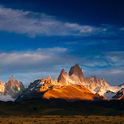 First light hits Cerro Torre and Mount Fitz Roy in Los Glacieres National Park, Argentina.