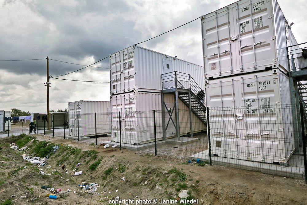 Contrasting of makeshift dwellings and new shipping containers converted to accommodating refugees and migrants at The Calais Jungle Camp in France