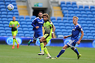 Danny Williams of Reading (c) gets to the ball ahead of Lex Immers of Cardiff city ®. EFL Skybet championship match, Cardiff city v Reading at the Cardiff city stadium in Cardiff, South Wales on Saturday 27th August 2016.<br /> pic by Andrew Orchard, Andrew Orchard sports photography.