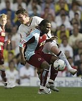 Photo: Aidan Ellis.<br /> Leeds United v Burnley. Coca Cola Championship. 14/04/2007.<br /> Leeds Alan Thompson battles with Burnley's Eric Djemba-Djemba