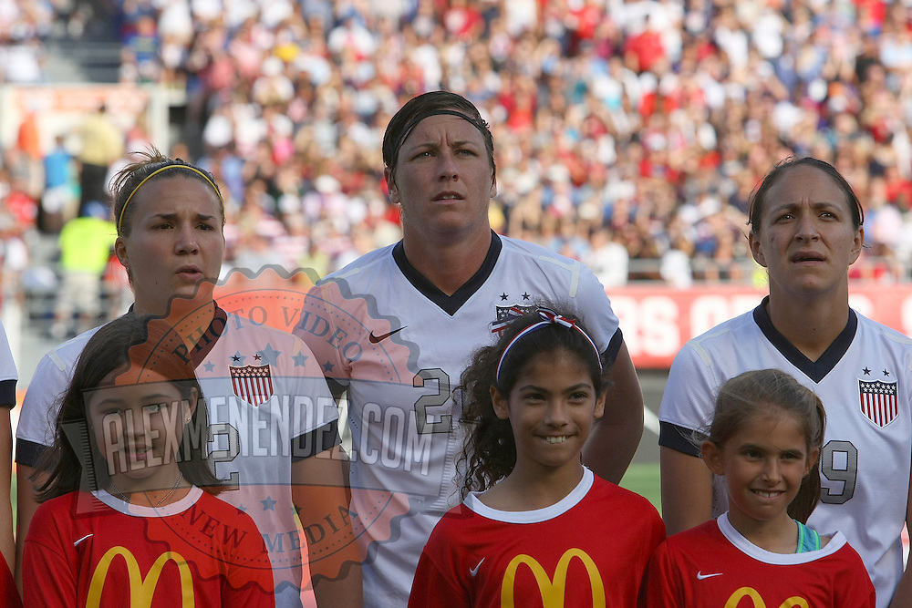 U.S. forward Abby Wambach (20) stands in attention during introductions, prior to  a women's soccer International friendly match between Brazil and the United States National Team, at the Florida Citrus Bowl  on Sunday, November 10, 2013 in Orlando, Florida. The U.S won the game by a score of 4-1.  (AP Photo/Alex Menendez)
