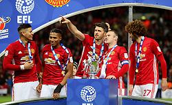 Michael Carrick of Wayne Rooney of Manchester United with the EFL Trophy - Mandatory by-line: Matt McNulty/JMP - 26/02/2017 - FOOTBALL - Wembley Stadium - London, England - Manchester United v Southampton - EFL Cup Final
