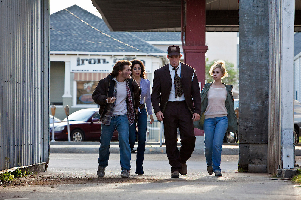 """Actors Emile Hirsch, Gina Gershon, Thomas Haden Church and Juno Temple in the feature film """"Killer Joe"""" directed by William Friedkin."""