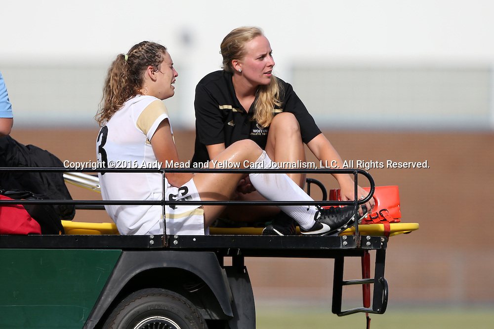 19 August 2016: Wofford's Rachel Fenner is tended to by the team's trainer as she is carted off of the field with a game-ending injury. The Duke University Blue Devils played the Wofford College Terriers in a 2016 NCAA Division I Women's Soccer match. Duke won the game 9-1.