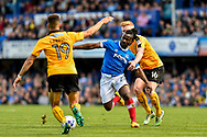 Portsmouth Midfielder, Stanley Aborah (29) and Cambridge United Midfielder, Liam O'Neil (16) and Cambridge United Defender, Jake Carroll (19)during the EFL Sky Bet League 2 match between Portsmouth and Cambridge United at Fratton Park, Portsmouth, England on 22 April 2017. Photo by Adam Rivers.