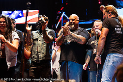 Harley-Davidson's Todd Robinson (Thor) with the Wounded Warrior tribute on the main stage on Jackyl night at the Full Throttle Saloon during the Sturgis Black Hills Motorcycle Rally. SD, USA. Thursday, August 8, 2019. Photography ©2019 Michael Lichter.