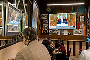 On a TV screen in Bar Italia, the famous Italian cafe in Soho, Prime Minister Boris Johnson addresses the the UK on live TV to announce a second nationwide lockdown during the second wave of the Coronavirus pandemic, on 31st October 2020, in London, England. Businesses like Bar Italia will again have to close except for takeaways, from midnight on Thursday for a period of one month.