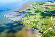 Nederland, Friesland, Gemeente Dongeradeel, 05-08-2014;; Peazemerlannen, kweldergebied grenzend aan het Wierumerwad en de Waddenzeee. Boven in beeld Lauwersmeer.<br /> Het gebied is ontstaan door spontane uitpoldering bij een storm in 1973 waarbij er een gat geslagen werd in de dijk. Rechts de zeedijk (op delta hoogte) in het midden de dijk van de zomerpolder. Het natuurgebied is in beheer bij It Fryske Gea. <br /> <br /> Peazemerlannen, salt marshes bordering the Wierumerwad and Waddenzeee. The area has been created in 1973, a severe storm made a hole in the outside polder dike. Right the seawall (delta height), in the middle the dike of the summer polder. The area is a nature reserve, managed by It Fryske Gea.<br /> luchtfoto (toeslag op standard tarieven);<br /> aerial photo (additional fee required);<br /> copyright foto/photo Siebe Swart