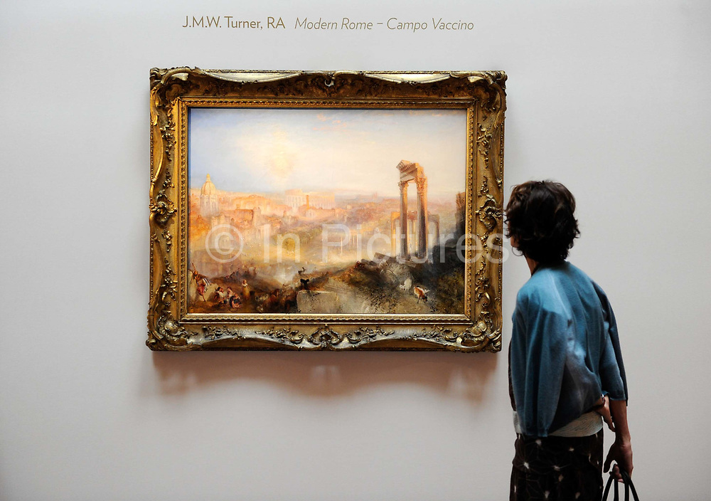 A woman looks at the painting, Modern Rome – Campo Vaccino by the British painter JM Turner at Sotheby's auction house. The painting sold for £29,721,150 at the auction at Sotheby's in central London.