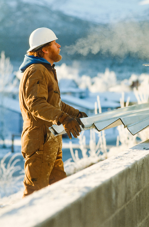 Alaska. Construction  workers face the harsh climate to provide Alaskan services.