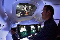 A man operating a NASA training simulator.