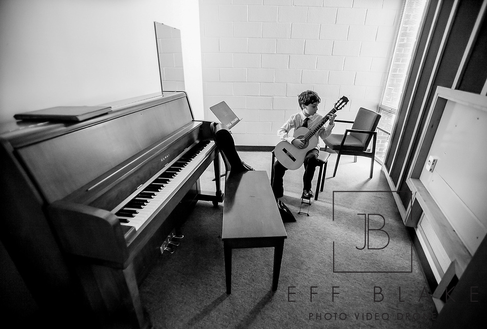 Ethan Speer, 10, rehearses before competing in the Southern Guitar Festival and Competition at Columbia College, an inaugural event that brings world-caliber guitarists to Columbia to inspire and educate guitar professionals and amateurs. Photo by Columbia, SC, photojournalist Jeff Blake