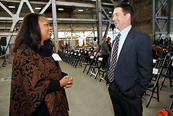 Annette Taylor, Sr. Community Development Analyst at City of Vallejo, talks with Tom Sheaff, of Lennar Mare Island as Blu Homes opened their West Coast factory on Mare Island in Vallejo, California Dec. 1, 2011.  Over 400 guests attended a ribbon cutting ceremony at the 250,000-square-foot facility.