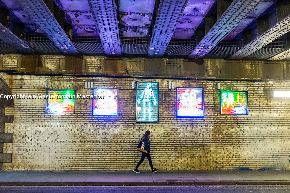 Street art made from colourful neon lights on underpass in central Edinburgh, Scotland, United Kingdom