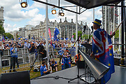 Steve Bray of pro EU campaign group SODEM addresses protesters crowded into  Parliament Square. With three days to go before the next Prime Minister of Great Britain is voted in by Conservative Party members, Boris Johnson looks to be the front runner. Thousands of people march through the streets of London demanding to remain in Europe and against  Boris Johnson as Prime Minister on 20th July, 2019 in London, United Kingdom.