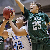 021514       Cable Hoover<br /> <br /> Window Rock Scout Marissa Charley (42) gets past Tuba City Warriors Tate Tsingine (25) and Samytha Parrish (4) Saturday at Chinle High School.