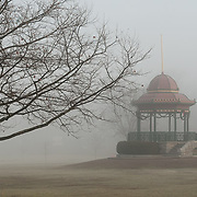 A thick early morning fog on the town common in Wakefield, Massachusetts, beside  Lake Quannapowitt.