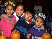 Family  in costumes at Youth Express Halloween party ages 30 3 and 4.  St Paul  Minnesota USA