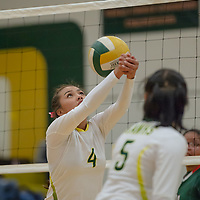 Hawks hitter Jalena Begay (4), sets up a forearm pass for a teammate, in Thoreau Tuesday night.