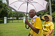 """Members of the Coalition against Death Alley and supporters  protest in front of the Governors Mansion in Baton Rouge Louisiana on the third day of a five day march through Louisiana's 'Cancer Alley' held by the Coalition Against Death Alley after being denied permits to march over river crossings. The Coalition Against Death Alley (CADA), is a group of Louisiana-based residents and members of various local and state organizations, is calling for a stop to the construction of new petrochemical plants and the passing of stricter regulations on existing industry in the area that include the groups RISE St. James, Justice and Beyond, the Louisiana Bucket Brigade, 350 New Orleans, and the Concerned Citizens of St. John  Louisiana's Cancer Alley, an 80-mile stretch along the Mississippi River, is also known as the """"Petrochemical Corridor,"""" where there are over 100 petrochemical plants and refineries ."""
