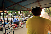 """Mar. 11, 2009 -- VIENTIANE, LAOS: Riding in a """"tuk-tuk"""" or three wheeled taxi, in Vientiane, Laos. Tuk-tuks are popular in much of the developing world.  Photo by Jack Kurtz / ZUMA Press"""