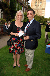 Actor ROBERT POWELL and his wife BABS at the Lady Taverners Westminster Abbey Garden Party, The College Garden, Westminster Abbey, London SW1 on 10th July 2007.<br />