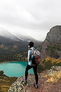 Female Hiker Overlooking Grinnell Lake in Glacier National Park, Montana