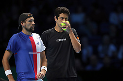 Poland's Lukasz Kubot (left) and Brazil's Marcelo Melo during their doubles match during day two of the NITTO ATP World Tour Finals at the O2 Arena, London. PRESS ASSOCIATION Photo. Picture date: Monday November 13, 2017. Photo credit should read: John Walton/PA Wire. RESTRICTIONS: Editorial use only, No commercial use without prior permission