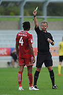Accrington Stanley Defender and new loan signing, Michael Ihekwe (4) shown a yellow card, booked during the EFL Sky Bet League 1 match between Accrington Stanley and Scunthorpe United at the Fraser Eagle Stadium, Accrington, England on 1 September 2018.
