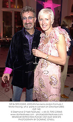 MR & MRS EDDIE JORDAN he owns Jordan Formula 1 Motor Racing, at a  party in London on 23rd April 2002.	OZF 140