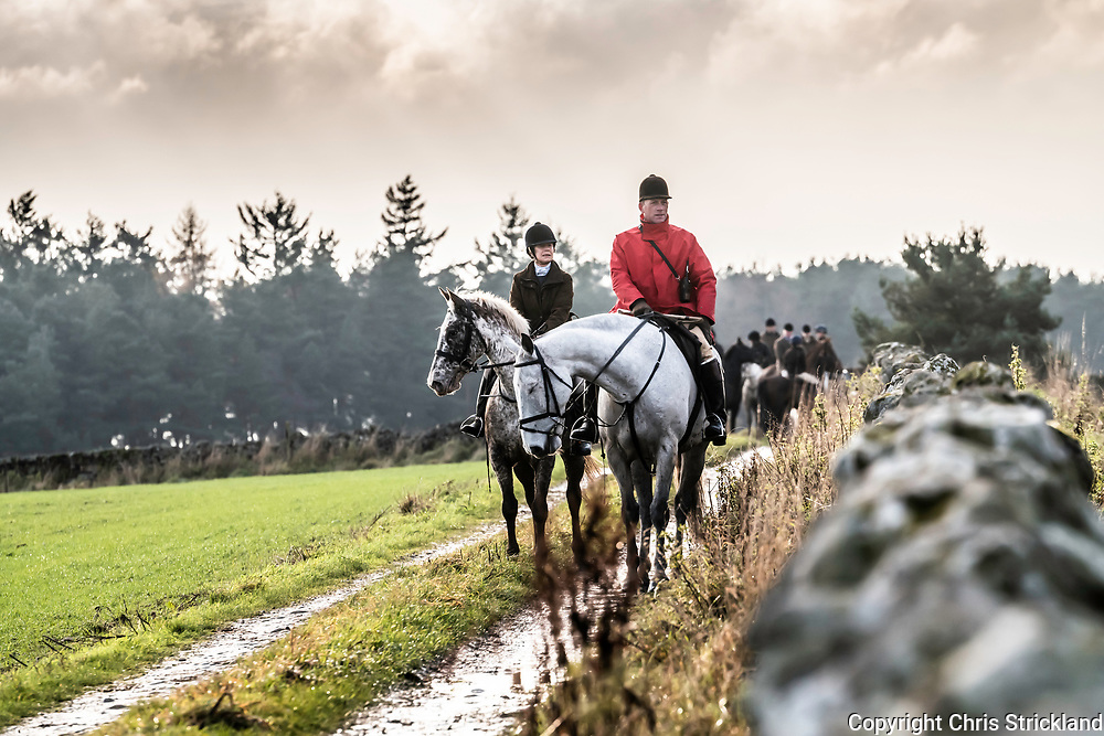 Ancrum, Jedburgh, Scottish Borders, UK. 21st November 2018. Mounted followers of the Duke of Buccleuch Hunt live up to the name of the Border Reiver, The Bold Buccleuch, as they meet in heavy rain and cold temperatures near Ancrum.