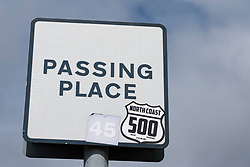 Detail of sign on the North Coast 500 tourist motoring route in northern Scotland, UK