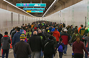 Thousands of people walk through the new Highway 99 tunnel Saturday as part of a car-free preview and weekend celebration. The tunnel, a replacement for the Alaskan Way Viaduct, opens to cars Monday. (Ellen M. Banner / The Seattle Times)