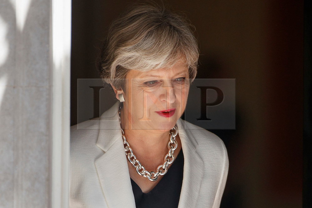 © Licensed to London News Pictures. 18/07/2017. London, UK. UK Prime Minister THERESA MAY comes out to greet Estonian Prime Minister Juri Ratas in Downing Street, London on Tuesday, 18 July 2017. Photo credit: Tolga Akmen/LNP
