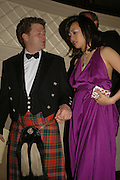 DUNCAN MACPHERSON AND CYNTHIA WU, The Royal Caledonian charity Ball 2006.Grosvenor House. London. 5 May 2006. . ONE TIME USE ONLY - DO NOT ARCHIVE  © Copyright Photograph by Dafydd Jones 66 Stockwell Park Rd. London SW9 0DA Tel 020 7733 0108 www.dafjones.com