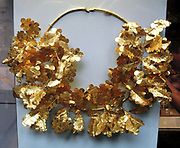Gold oak wreath with a bee and two cicadas.  350-300 BC.  Said to be from the Dardanelles.  Each branch, made of sheet gold tubes, has six sprays with  eight leaves and seven or eight acorns, as well as a cicada.  Perhaps the most famous oak wreath is that from a tomb in Virginia, identified as the tomb of Philip II.  Another comes from the nearby Prince's tomb.  A particularly fine example was discovered in a tumulus at Pergamon.