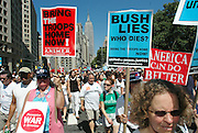 Protesters gather to march in protest of President Bush and his administration's agenda.